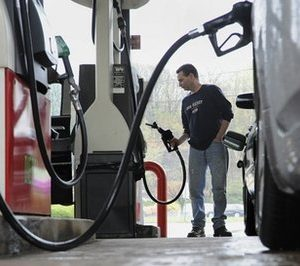 John Magel pumps gas at a station in Wethersfield, Conn. Consumers paid more for gas and food in April, lifting inflation to its highest level in two and a half years. But inflationary pressures have begun to ease in May 2011, and analysts say some prices could taper off by summer. (AP Photo/Jessica Hill, file)