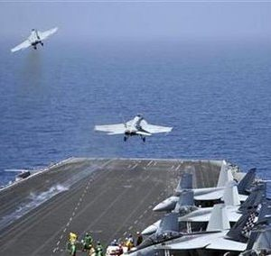 F/A-18F Super Hornets assigned to Carrier Air Wing One (CVW-1) launch  from the aircraft carrier USS Enterprise in the Red Sea in this U.S. Navy handout photo dated March 17, 2011.  (U.S. Navy/Mass Communication Specialist Seaman Jared M. King)