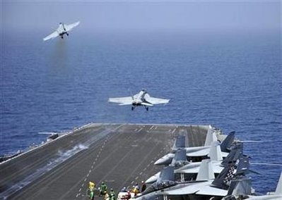 US Navy handout photo of F/A-18 fighter jets launching from the USS Enterprise in the Red Sea