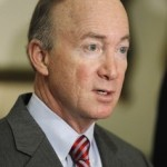 Indiana Gov. Mitch Daniels talks about the improved state revenue forecast during a news conference at the Statehouse in Indianapolis, in this April 15, 2011 file photo. In a middle-of-the-night message on Sunday May 22, 2011, Daniels said he was taking the advice of his family and would skip a White House bid in 2012. (AP Photo/Darron Cummings, File)