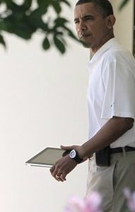 President Barack Obama carries his iPad as he departs the Oval Office at the White House in Washington for an afternoon of golf Saturday, May 21, 2011. (AP Photo/J. Scott Applewhite)