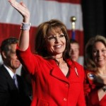 Former Alaska Governor Sarah Palin waves during a fundraiser at Colorado Christian University in Lakewood, Colo. Palin has authorized a feature-length film about her rise, added staff and recently said she has &quot;that fire in the belly&quot; for a presidential bid,  all steps that fuel speculation she&#039;s inching toward a White House run. (AP Photo/Ed Andrieski)
