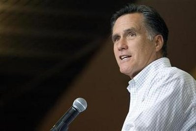 Former Massachusetts Governor and likely Republican presidential candidate Mitt Romney answers questions from reporters after meeting with students at the University of Nevada, Las Vegas in Las Vegas, Nevada May 16, 2011. REUTERS/Las Vegas Sun/Steve Marcus