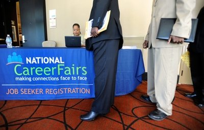 Job seekers form a line at the registration desk of a job fair in Linthicum, Md. Tuesday, May 24, 2011. More people applied for unemployment benefits last week, the first increase in three weeks and evidence that the job market is still sluggish. (AP Photo/Steve Ruark)