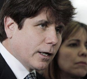 Former Illinois Gov. Rod Blagojevich addresses the media accompanied by his wife Patti, (AP Photo/M. Spencer Green, File)