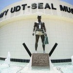 A statue of a frogman stands outside the entrance to the Navy UDT-SEAL Museum in Fort Pierce, Fla. The biggest attraction at the Navy SEALs&#039; national museum isn&#039;t memorialized in any artifact or mentioned in any display. But that doesnt keep visitors from asking. The May 2 killing of Osama bin Laden at the hands of SEALs has brought a spike in visitors to the National Navy UDT-SEAL Museum, seeking a behind-the-scenes glimpse of how the mission was pulled off.    (AP Photo/J Pat Carter)