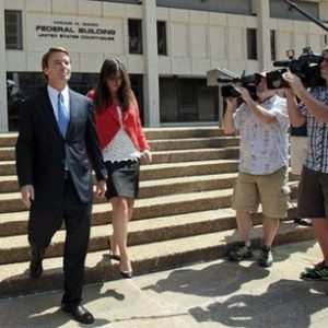 Former presidential candidate John Edwards is seen with his daughter Cate following a court appearance in Winston-Salem, N.C., Friday, June 3, 2011. A grand jury indicted the two-time presidential candidate on Friday, accusing him of trying to protect his political ambitions by soliciting and secretly spending more than $925,000 to hide his mistress and their baby from the public. (AP Photo/Gerry Broome)