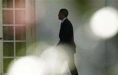 Obama walks to the Oval Office  in Washington