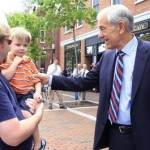 Republican Presidential hopeful, Rep. Ron Paul, R-Texas, right, greets Aaron Goodro and his son Ian during a campaign stop  in Portsmouth, N.H., Friday, June 10, 2011. (AP Photo/Jim Cole)