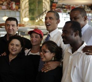 President Barack Obama, center, and Rep. Kendrick Meek, D-Fla., second from right, pose for photos at Jerry's Famous Deli after a fundraiser for Florida Democrats, in this Aug. 18, 2010 file photo taken in Miami Beach, Fla. President Barack Obama has problems in Florida that he didn't have when he won the pivotal swing state in 2008. The challenges show why Obama has been a frequent visitor to the Sunshine State. (AP Photo/Carolyn Kaster, FILE)