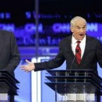 Mitt Romney (left) and Ron Paul at GOP debate (Reuters)