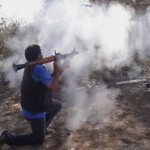 Rebel fighters fires towards pro-Moammar Gadhafi forces at the front line of Dafniya, west of Misrata, Libya, Wednesday , June 15, 2011. In recent days rebel forces have advanced along the Mediterranean coast toward Zlitan, but say they have been instructed by NATO to withdraw _ ahead of expected bombing runs _ to old front lines in Dafniya, 16 miles (25 kilometers) west of Misrata. (AP Photo/Hassan Ammar)