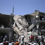 People inspect the rubble of a residential building, which Libyan officials say was hit by a NATO air strike, in Tripoli's Souq al-Juma district June 19, 2011. REUTERS/Nick Carey