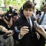 Former Illinois Gov. Rod Blagojevich greets supporters as he arrives home in Chicago, Monday, June 27, 2011, after a jury convicted him of 17 of the 20 charges against him, including all 11 charges related to his attempt to sell or trade President Barack Obama's vacated Senate seat. (AP Photo/Paul Beaty)