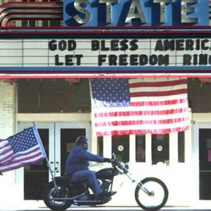 A biker passes by a theater marquee in Falls Church, Virginia, on Sept. 15, 2001 -- four days after 9/11. (Photo by Doug Thompson)