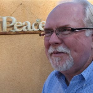 Ron Barber, aide to Rep. Gabrielle Giffords, is shown at his home in Tucson, Ariz. Barber has returned to work for the first time since being seriously injured in the Tucson mass shooting nearly six months ago. Barber was shot in the cheek and thigh during the Jan. 8 attack, which killed six people and injured 13, including Barber and Giffords. The 65-year-old has spent the past six months undergoing extensive physical therapy and coping with the trauma of the shooting. (AP Photo/Allen Breed)