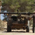 Rebel fighters load their vehicle-mounted weapon on the outskirts of Zlitan, near Misrata's western frontline (Reuters)