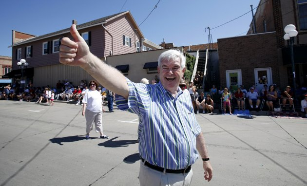 Newt Gingrich waves while walking in a Fourth of July parade in Clear Lake, Iowa. Since aides and advisers resigned in early June, Newt Gingrich's presidential bid has been on life support. And his first campaign finance disclosure provided little reason to be optimistic. Gingrich has raised $2.1 million since getting into the race earlier this year, badly trailing front-runner Mitt Romney. (AP Photo/Charlie Neibergall)