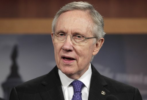 Senate Majority leader Harry Reid of Nev., speaks to reporters on Capitol Hill in Washington, Monday as he announced a new proposal to solve the debt limit crisis. (AP Photo/J. Scott Applewhite)