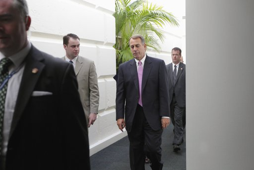 House Speaker John Boehner of Ohio walks through a basement corridor in the Capitol in Washington, Wednesday, after an afternoon caucus with House Republicans seeking an agreement on legislation to raise the nation's debt limit. (AP Photo/J. Scott Applewhite)