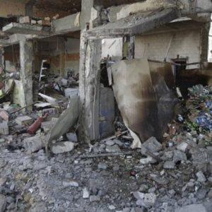 An Iraqi man inspects a destroyed liquor store after a bomb attack in Baghdad, Iraq, Thursday, July 28, 2011. (AP Photo/Karim Kadim)
