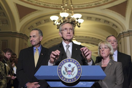 Senate Majority Leader Harry Reid of Nev., center, accompanied by fellow Senate Democratic leaders, speaks on Capitol Hill in Washington, Tuesday, Aug. 2, 2011, after passage of the emergency legislation to prevent a default on government debt obligations. From left are, Sen. Charles Schumer, D-N.Y., Reid, Sen. Patty Murray, D-Wash., and Senate Majority Whip Richard Durbin of Ill (AP Photo/J. Scott Applewhite)