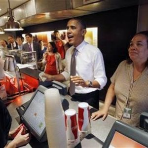 President Barack Obama orders an hamburger and fries at the Good Stuff Eatery on Capitol Hill in Washington. REUTERS/Jason Reed