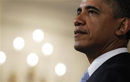 President Barack Obama delivers a statement on the lowering of the U.S. credit rating and the Afghan helicopter crash in the State Dining Room of the White House in Washington, August 8, 2011. REUTERS/Jason Reed