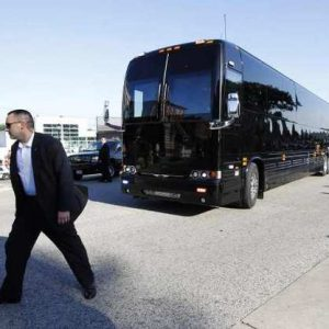 A Secret Service agent walks in front of President Obama's bus during a stop in Le Claire, Iowa, on Tuesday. (Jason Reed/Reuters)