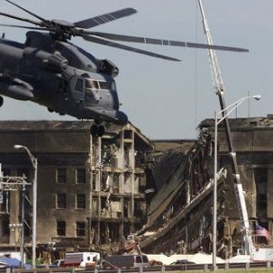 In this Wednesday, Sept. 12, 2001 file photo, a military helicopter ascends after dropping off personnel at the Pentagon a day after a hijacked airliner crashed into the Department of Defense building in Washington. (AP Photo/Ron Edmonds)