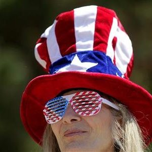 Karen Patterson listens to speakers during a Tea Party rally in Napa, California. REUTERS/Robert Galbraith