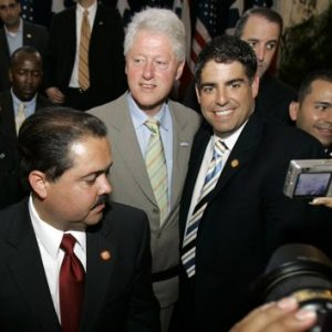 In this April 7, 2008 file photo, Puerto Rico's Senator Roberto Arango, right, poses for a photo with former U.S. President Bill Clinton, center, after the unveiling ceremony of a statue of former President Franklin D. Roosevelt at the Capitol building in San Juan, Puerto Rico. (AP Photo/Andres Leighton)