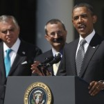 President Barack Obama, accompanied by Transportation Secretary Ray LaHood, left, and U.S. Chamber of Commerce Chief Operating Officer David Chavern, speaks in the Rose Garden of the White House in Washington, Wednesday, Aug. 31, 2011, to urge Congress to pass a federal highway bill. (AP Photo/Carolyn Kaster)