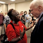 Sen. John McCain, R-Ariz., right, talks with an attendee during a town hall meeting in Goodyear, Ariz.  (AP Photo/Ross D. Franklin)
