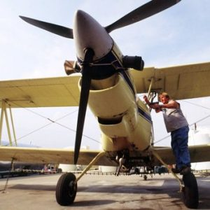 Robert Williams of Mihand Aircraft near England, Ark., places the engine cover back on his agricultural airplane after removing the battery cable. Federal officials allowed crop-spraying planes to return to the skies as long as they stayed away from commercial airports, one day after they were grounded because of security concerns after the previous week's terrorist attacks. On Friday, Sept. 2, 2011, the FBI and Homeland Security have issued a nationwide warning about al-Qaida threats to small airplanes, just days before the anniversary of the 2001 terrorist attacks. (AP Photo/Spencer Tirey, File)