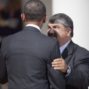 AFL-CIO President Richard Trumka talks to President Barack Obama in the Rose Garden. (AP Photo/Evan Vucci, File)
