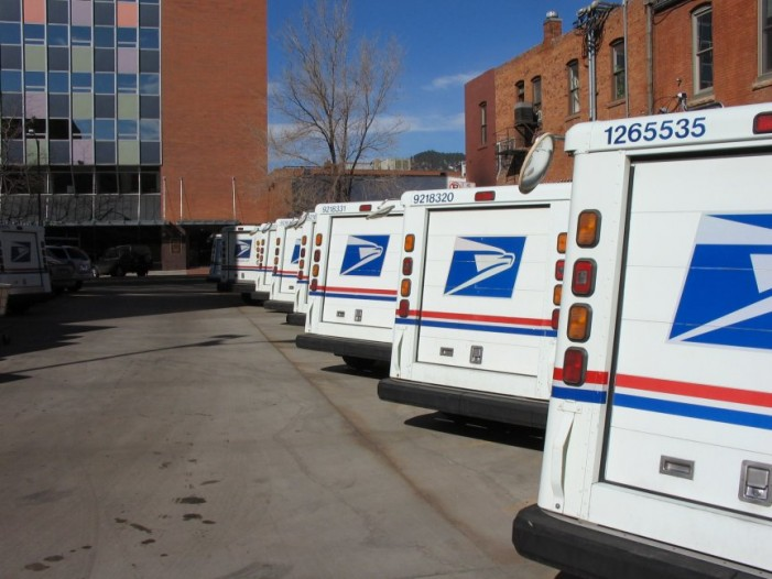 Postal service loses $22 billion in latest quarter
