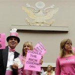 "Demonstrators from the activist group ""Code Pink"" hold up signs of protest prior to the opening session of the Congressional Super Committee, which is searching for at least $1.2 trillion in new deficit reductions, in Washington, DC, September 8, 2011. REUTERS/Mike Theiler"