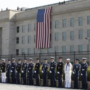 Honor guards stand at the Pentagon Memorial on the 10th anniversary of the September 11 attacks at the Pentagon in Washington, Sunday, Sept. 11, 2011. (AP Photo/Charles Dharapak)