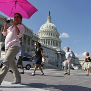 Tourists cross the plaza on Capitol Hill in Washington, Monday, Sept. 12, 2011. (AP Photo/J. Scott Applewhite)