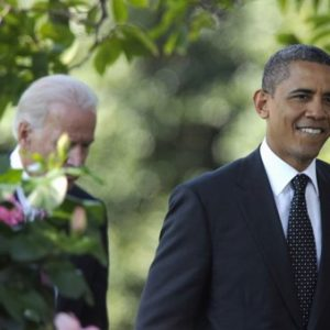 President Barack Obama, followed by Vice President Joe Biden, walks into the Rose Garden of the White House in Washington, Monday, Sept. 12, 2011, to speak about the American Jobs Act. (AP Photo/Susan Walsh)