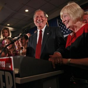 "Bob Turner, center, joined by his wife Peggy, right, and family smiles as he delivers his victory speech during an election night party, Wednesday, Sept. 14, 2011 in New York. Turner says his shocking win in a heavily Democratic New York City district is a ""loud and clear"" message to Washington. (AP Photo/Mary Altaffer)"
