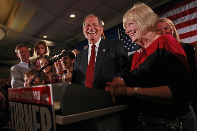 """Bob Turner, center, joined by his wife Peggy, right, and family smiles as he delivers his victory speech during an election night party, Wednesday, Sept. 14, 2011 in New York. Turner says his shocking win in a heavily Democratic New York City district is a """"loud and clear"""" message to Washington. (AP Photo/Mary Altaffer)"""