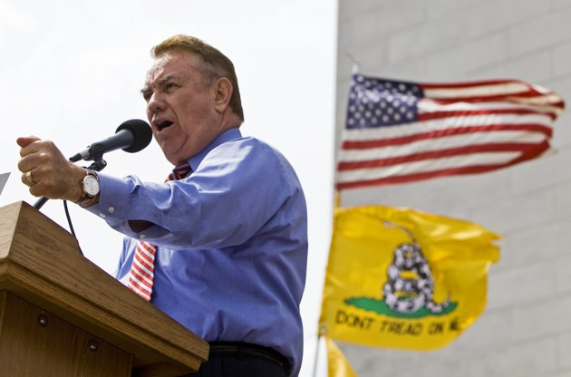 Wisconsin Gov. Tommy Thompson addresses a tea party rally in Madison, Wis. Once the face of the Republican Party in Wisconsin, former Gov. Tommy Thompson now finds himself having to explain his conservative credentials as he mulls entering a U.S. Senate race. (AP Photo/Andy Manis, File)