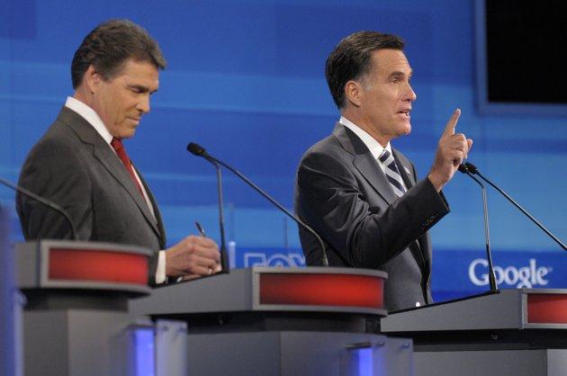GOP Presidential contenders Rick Perry (left) and Mitt Romney (AP Photo/Phelan M. Ebenhack, Pool)