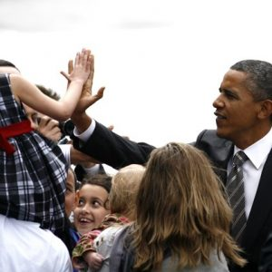 President Barack Obama greets supporters after disembarking Air Force One at Boeing Field Sunday. (AP Photo/Joe Nicholson)