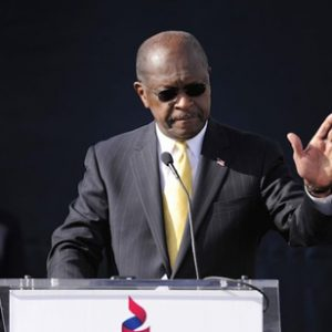 Herman Cain calls it quits (David Tulis/AP)