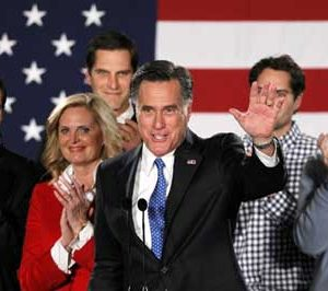 Romney and family celebrate in Iowa (REUTERS/Rick Wilking)