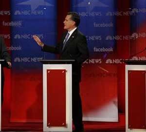 Rick Santorum, Mitt Romney and Ron Paul (REUTERS/Jessica Rinaldi)