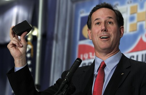 Republican presidential candidate, former Pennsylvania Sen. Rick Santorum holds a piece of oil-rich shale rock from North Dakota while speaking at an Economic Club of Detroit luncheon in Detroit, Thursday, Feb. 16, 2012. (AP Photo/Paul Sancya)